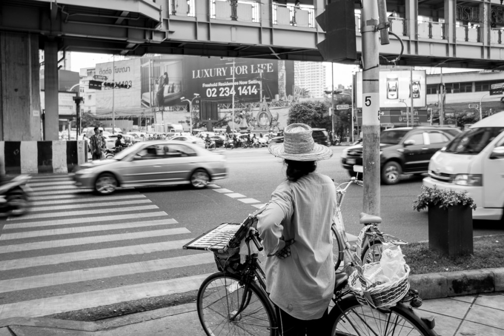 A woman waiting to cross Rama I Rd. Crossings in Bangkok always giving us an adrenaline rush, since absolutely no one is actually paying attention to traffic lights.